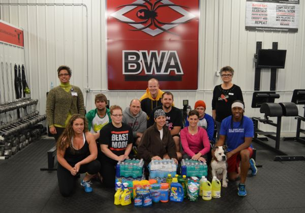 Black Widow Academy Provides Donations to the Caring Club House