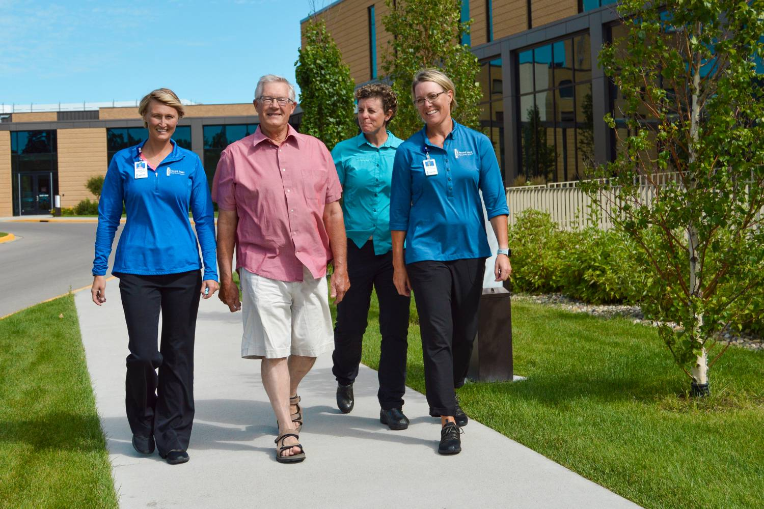 Kevin Walking with Rehab Team Members